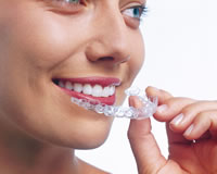 Young woman using Invisalign Aligner