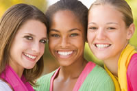 Three female teenagers with Invisalign